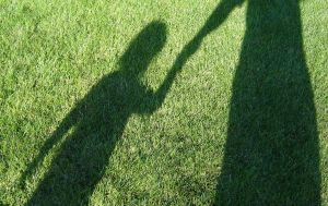Holding hands shadow Charlotte North Carolina Divorce Family Law Child Custody Attorney Lawyer.jpg
