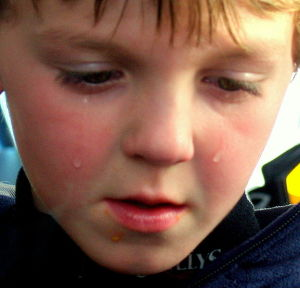 Sad-Child-Charlotte-Mecklenburg-Divorce-Attorney-North-Carolina-Family-Law-Lawyer-300x288