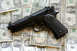 Handgun on pile of cash Charlotte Divorce Lawyer
