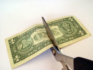 Cutting-money-in-half-Charlotte-Monroe-Mooresville-Divorce-Lawyer-Attorney-300x225