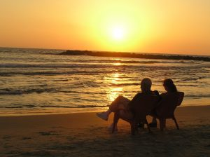 sunset-couple-talking-Charlotte-Monroe-Lake-Norman-Family-Law-Attorney-300x224