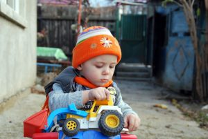 child-playing-with-toy-car-Charlotte-Monroe-Lake-Norman-Child-Custody-Attorney-300x201
