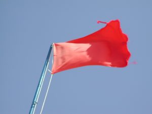 red-flag-Charlotte-Monroe-Mooresville-Domestic-Violence-Attorney-300x225