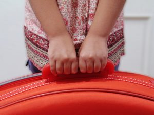 child-with-suitcase-Charlotte-Union-County-Iredell-County-Child-Custody-Order-Lawyer-300x225