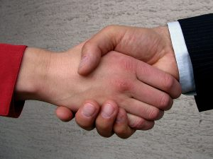 shaking-hands-mediator-arbitration-Charlotte-Mooresville-Monroe-Family-lawyer-300x225