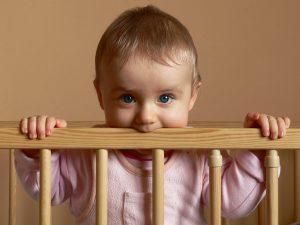 child-in-crib-Charlotte-Monroe-Lake-Norman-Family-Law-Attorney-300x225