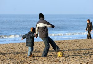 playing-on-the-beach-Charlotte-Monroe-Mooresville-Child-Custody-Lawyers-300x205